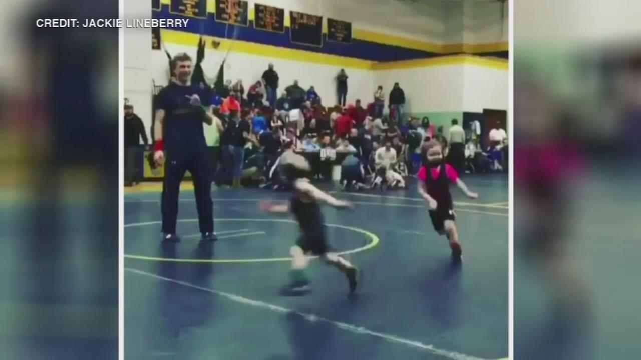Young wrestler runs away from competitor