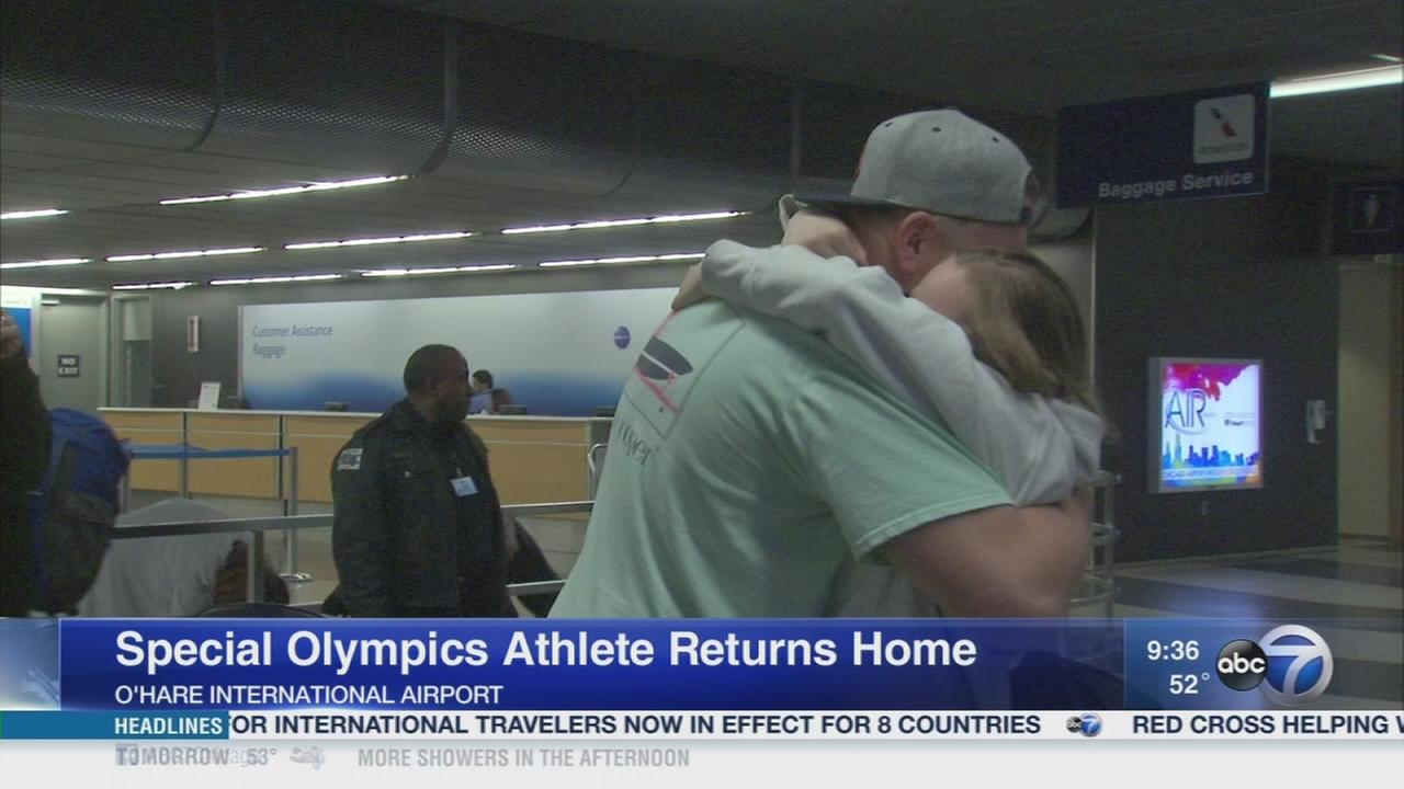 Special Olympians return home