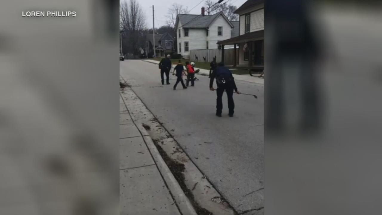 Instead of ending street hockey game, cops join in