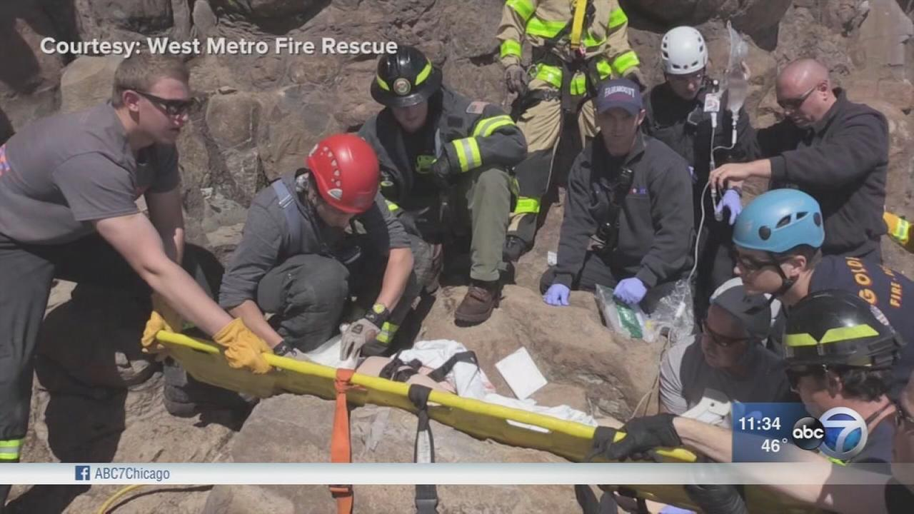 Woman trapped under large fallen boulder