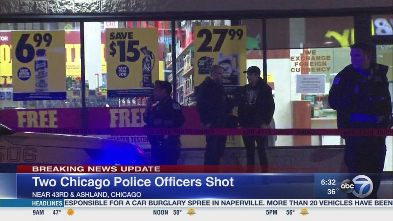 Several questioned after 2 officers shot