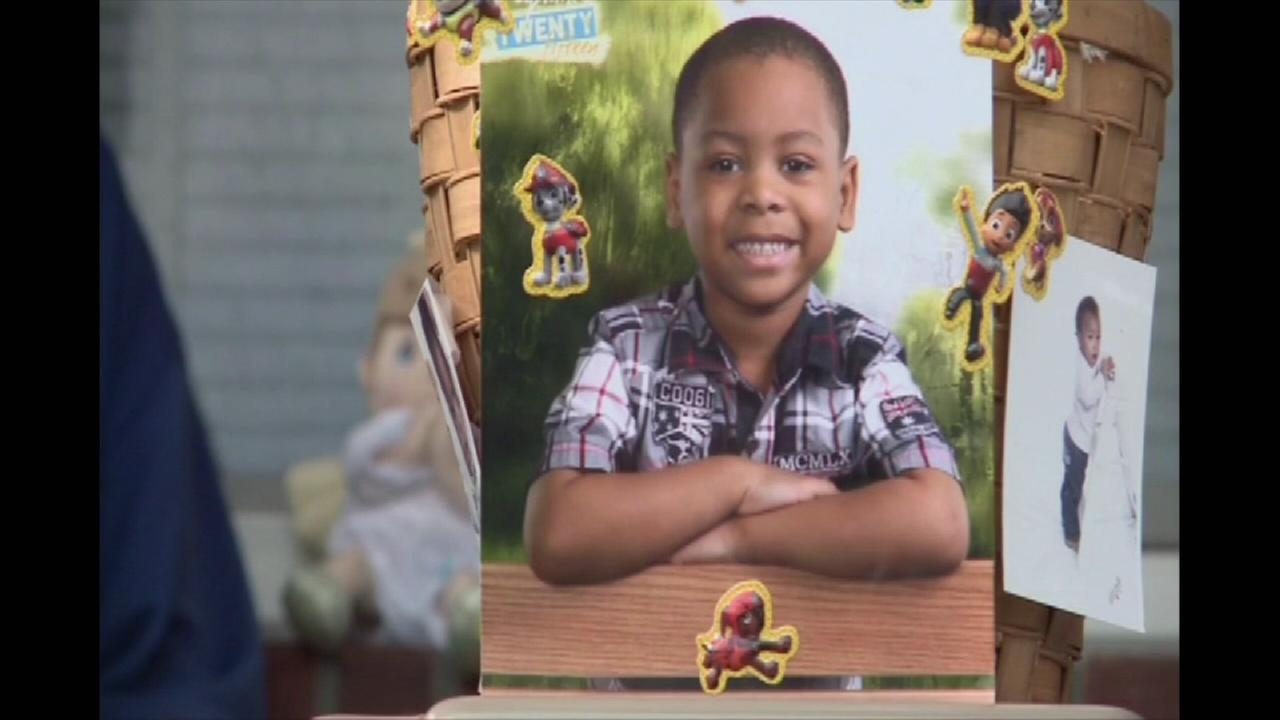 Boy killed by stray bullet at kitchen table