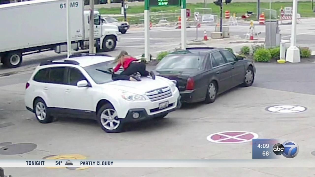 Wisconsin woman jumps on hood as carjacker tries to drive off