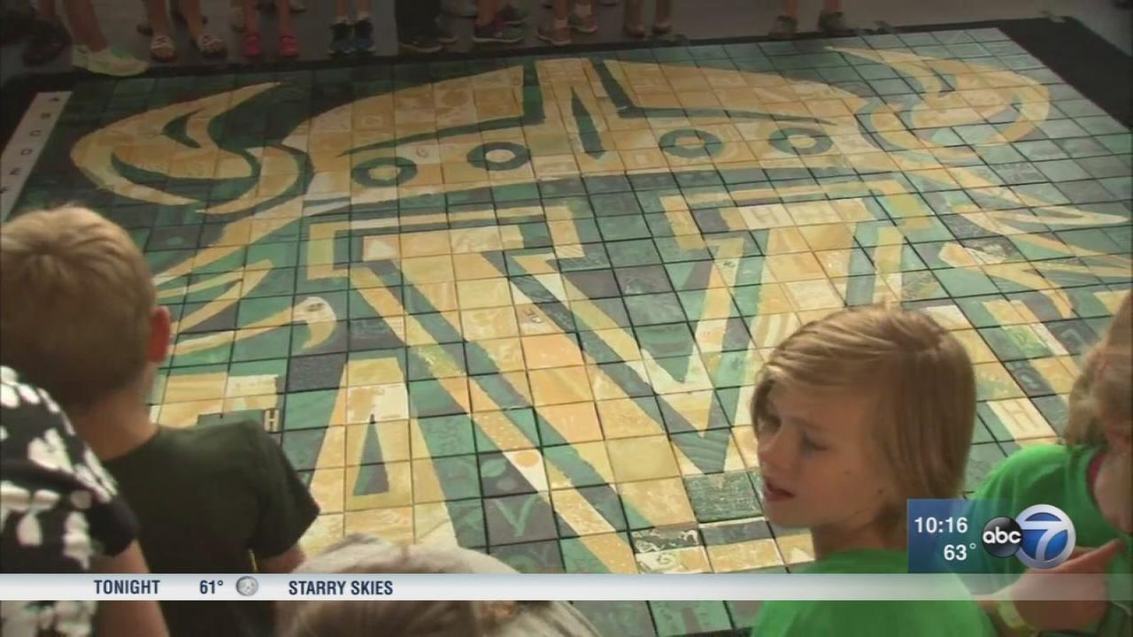 Students and staff of new Valparaiso school paint mural