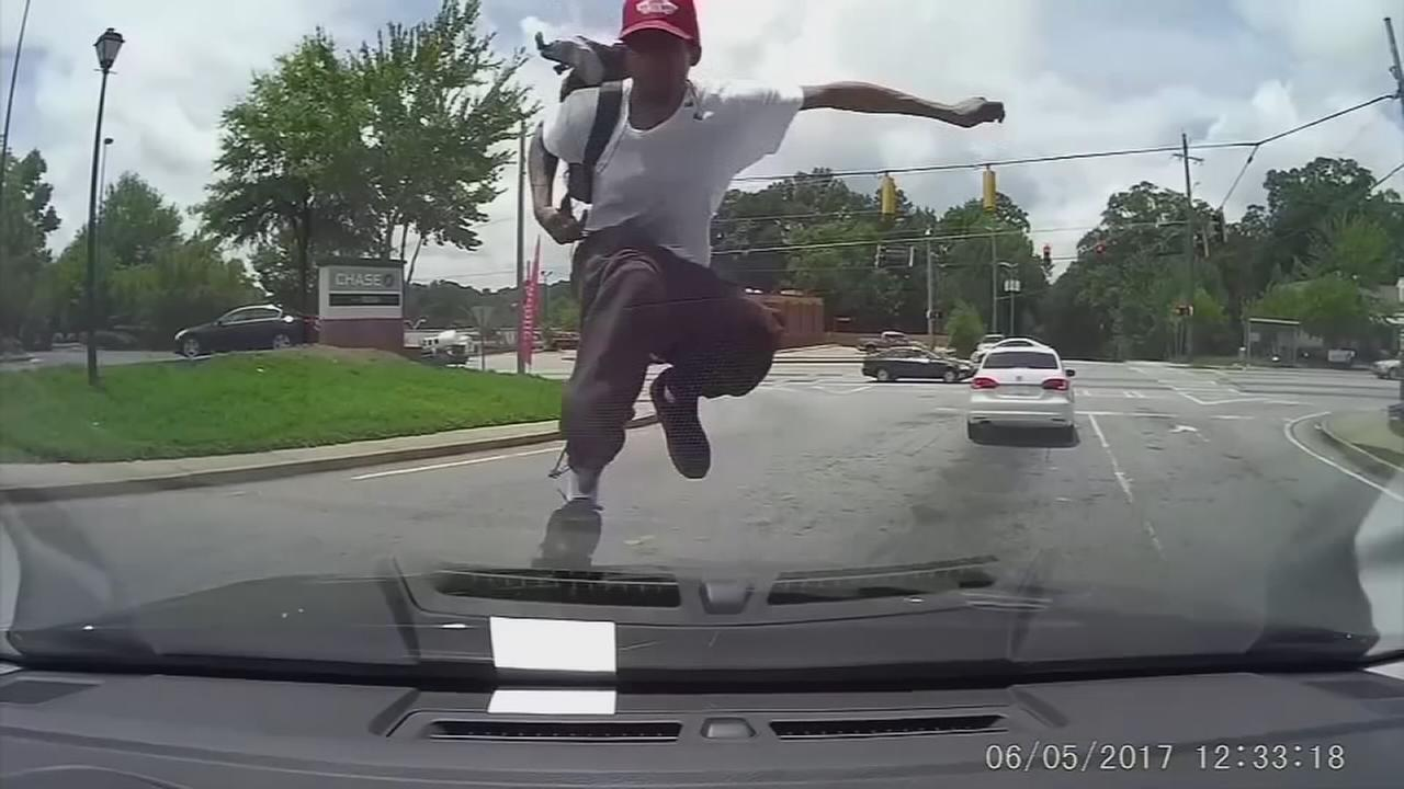 Man smashes windshield in random attack