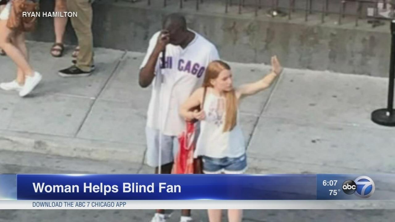 Woman helps blind Cubs fan hail cab
