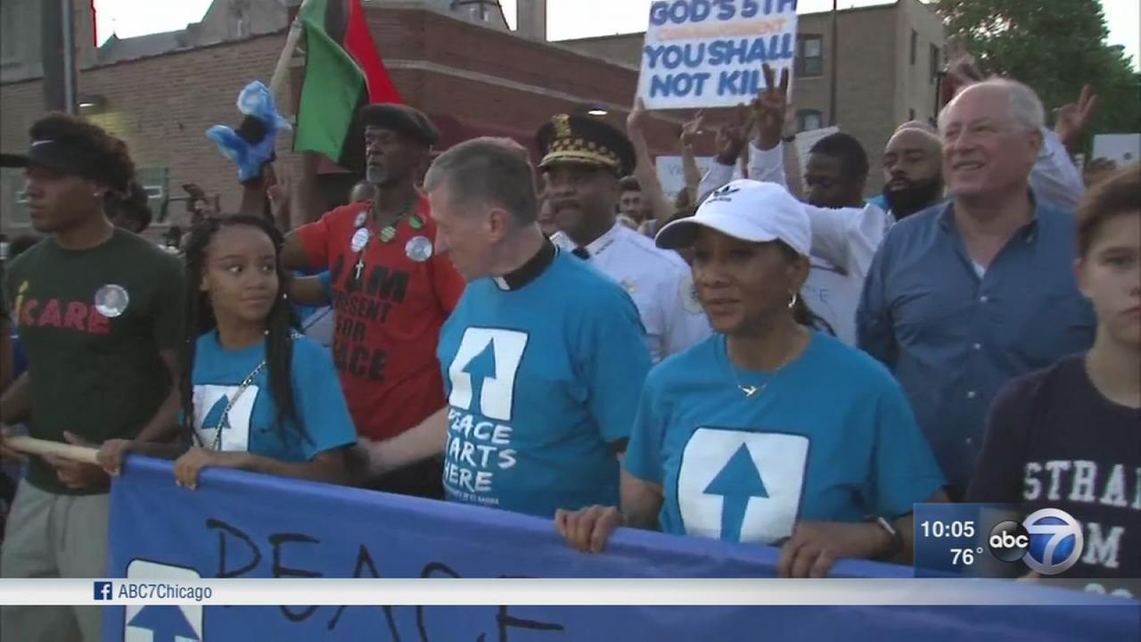 Hundreds gather for peace walk ahead of school years end