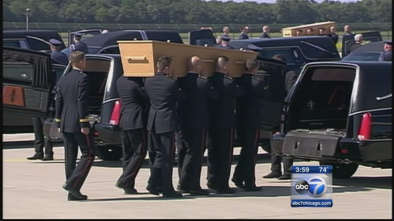 Malaysia Airlines victims bodies arrive in Netherlands