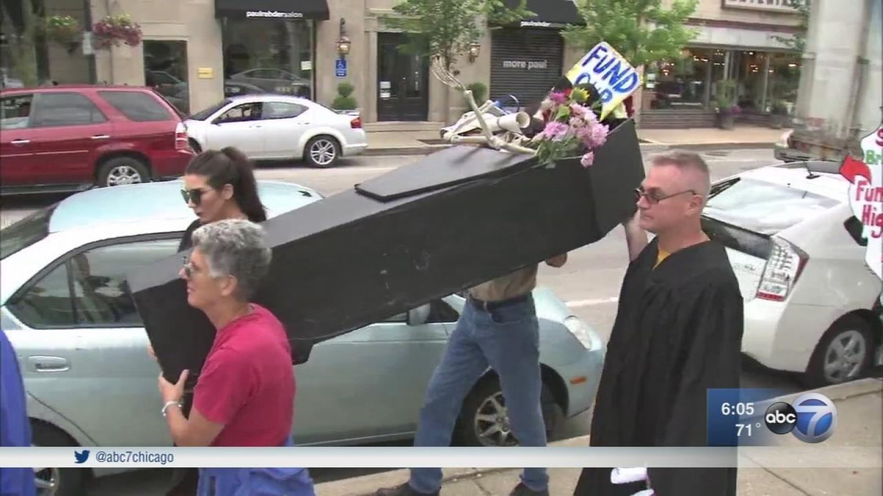 NEIU faculty, students hold funeral march for Illinois higher education