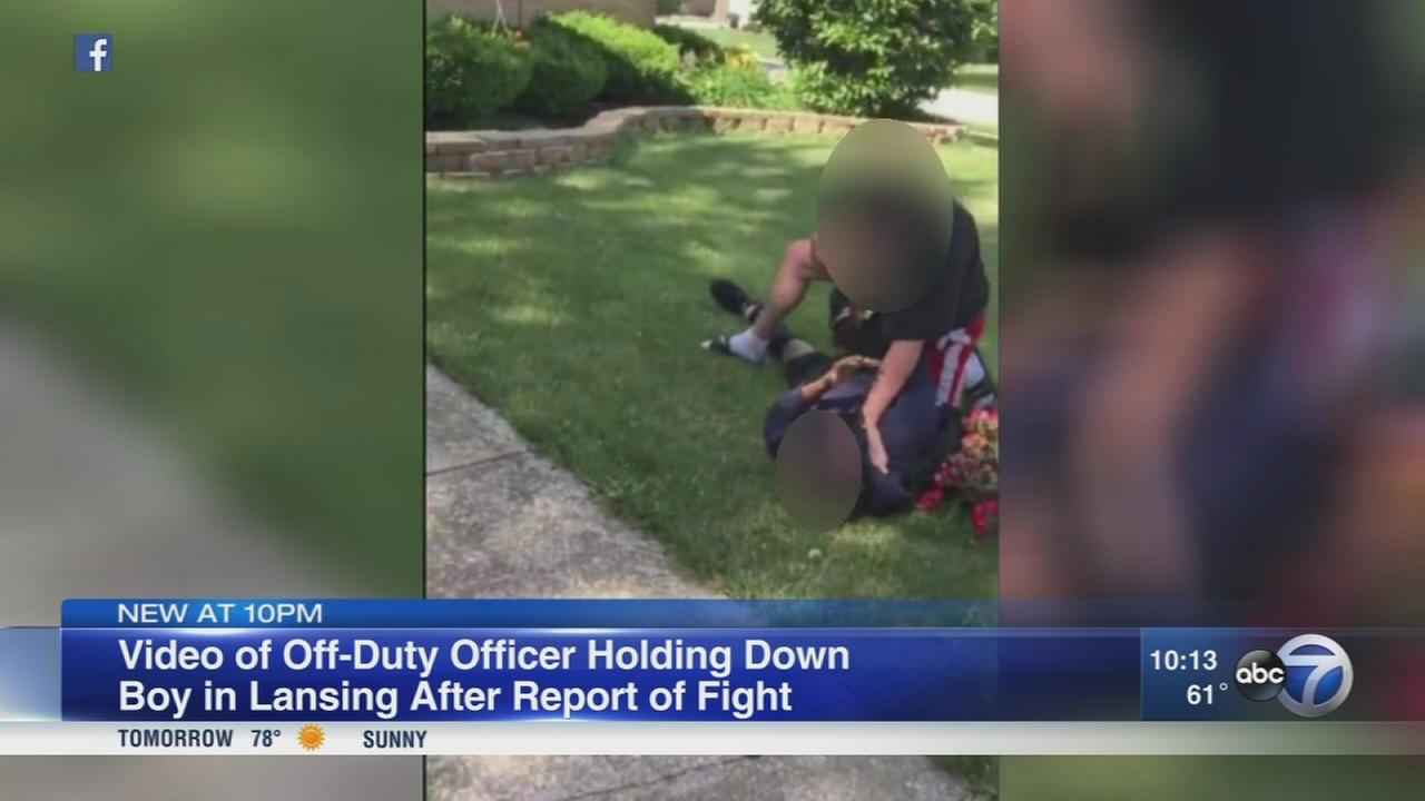 Video of off-duty officer holding down boy goes viral