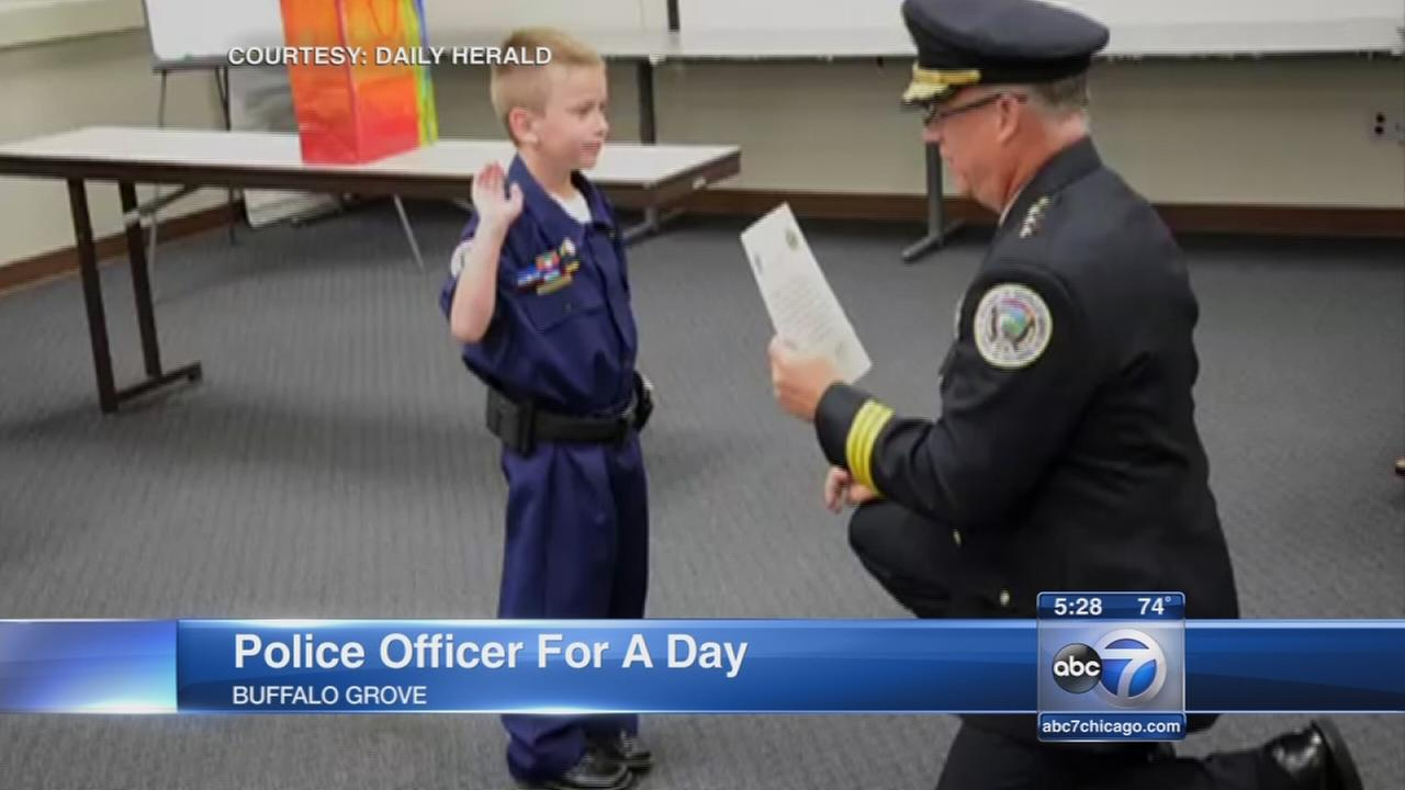 Boy with heart defect is cop for a day