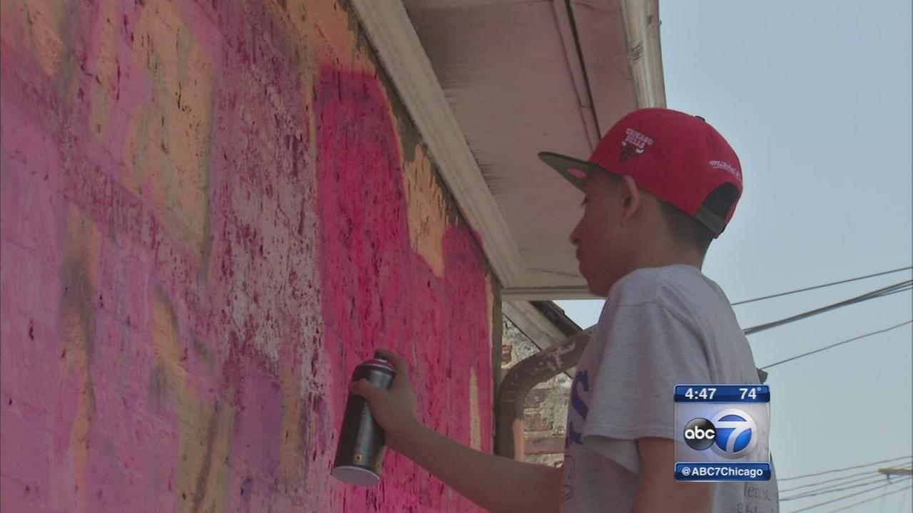 Little Village youth paid to remove graffiti, paint murals