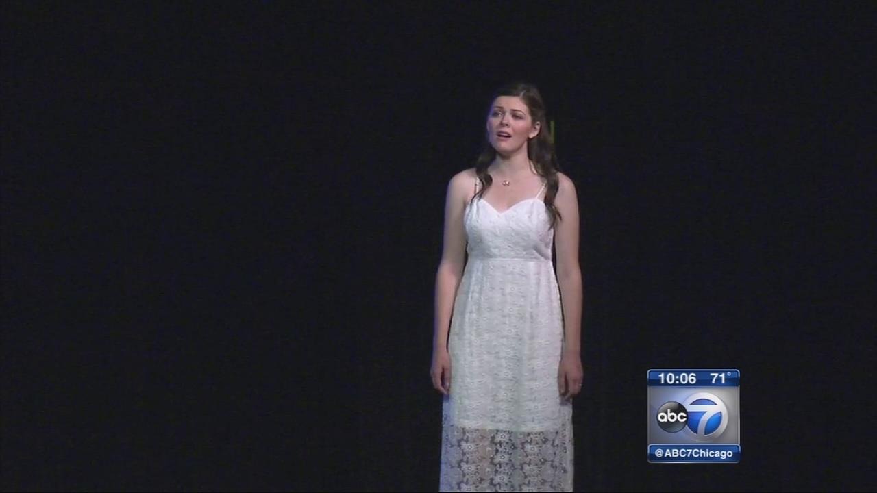 Mundelein grad takes stages 3 months after brain surgery