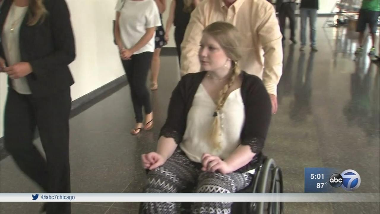 Paralyzed dancer testifies in case against city