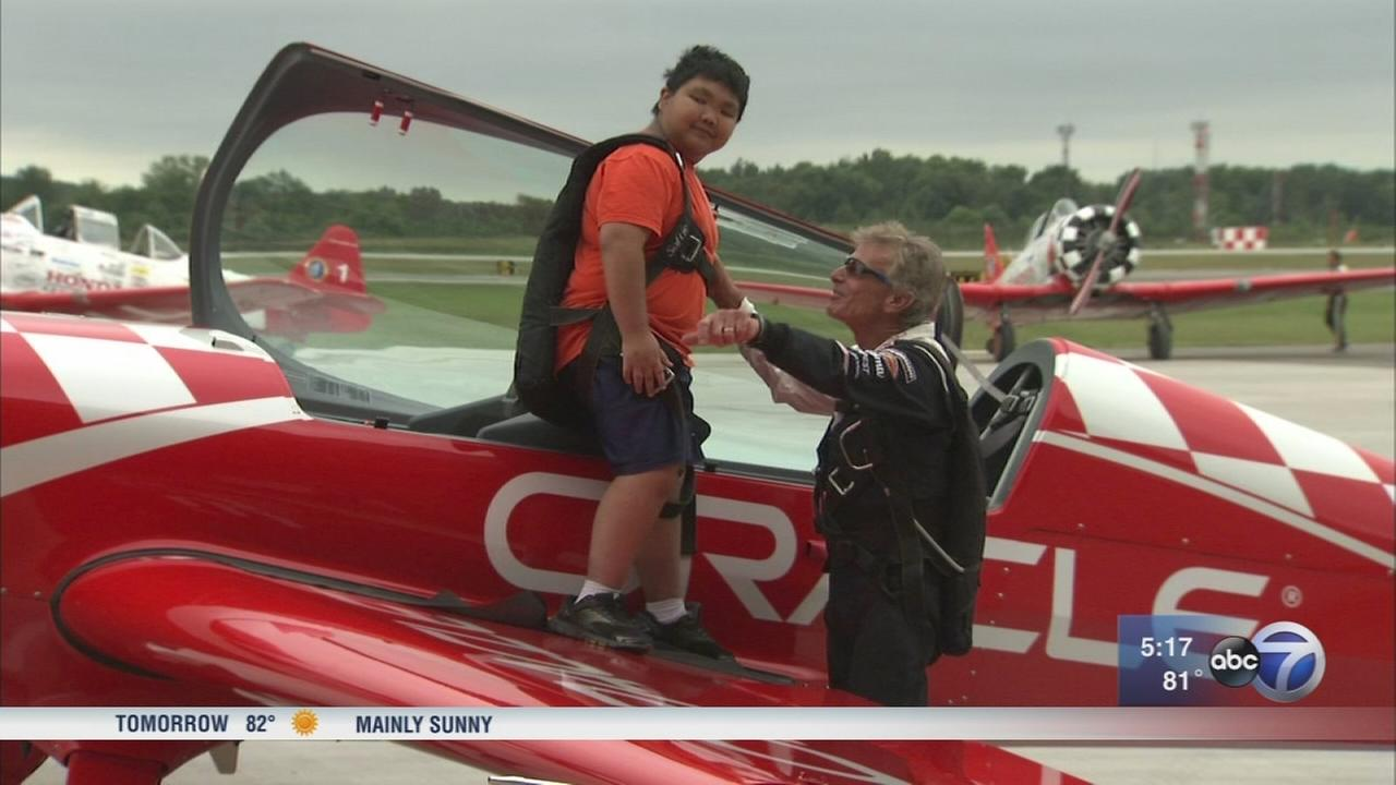 Boy takes flight with star pilot, honors late father
