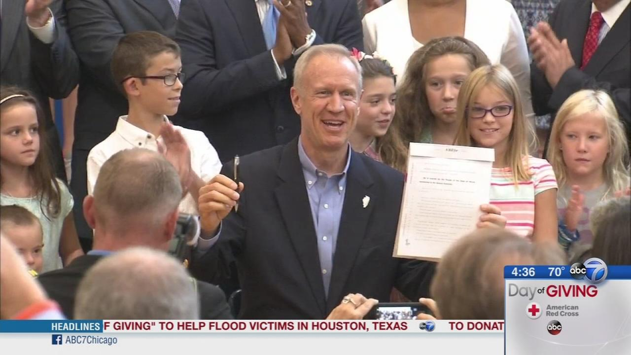 Governor Rauner signs education bill into law