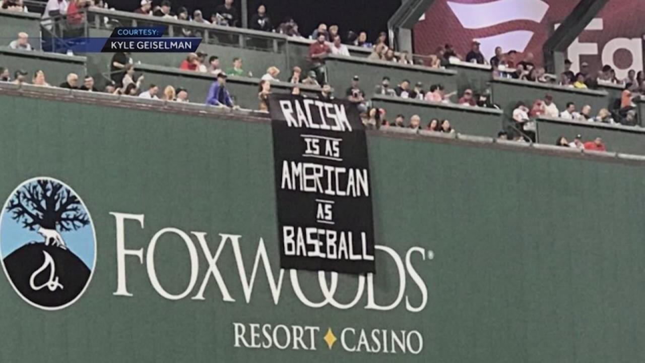 Racism banner gets fans removed from Fenway Park