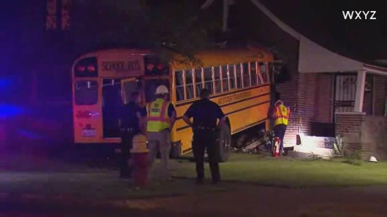 Michigan bus crashes into house