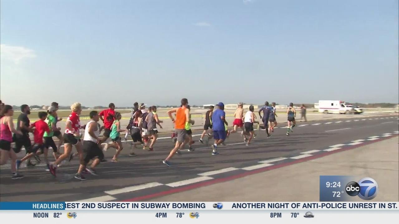 Runners take off at the Midway Fly Away 5K