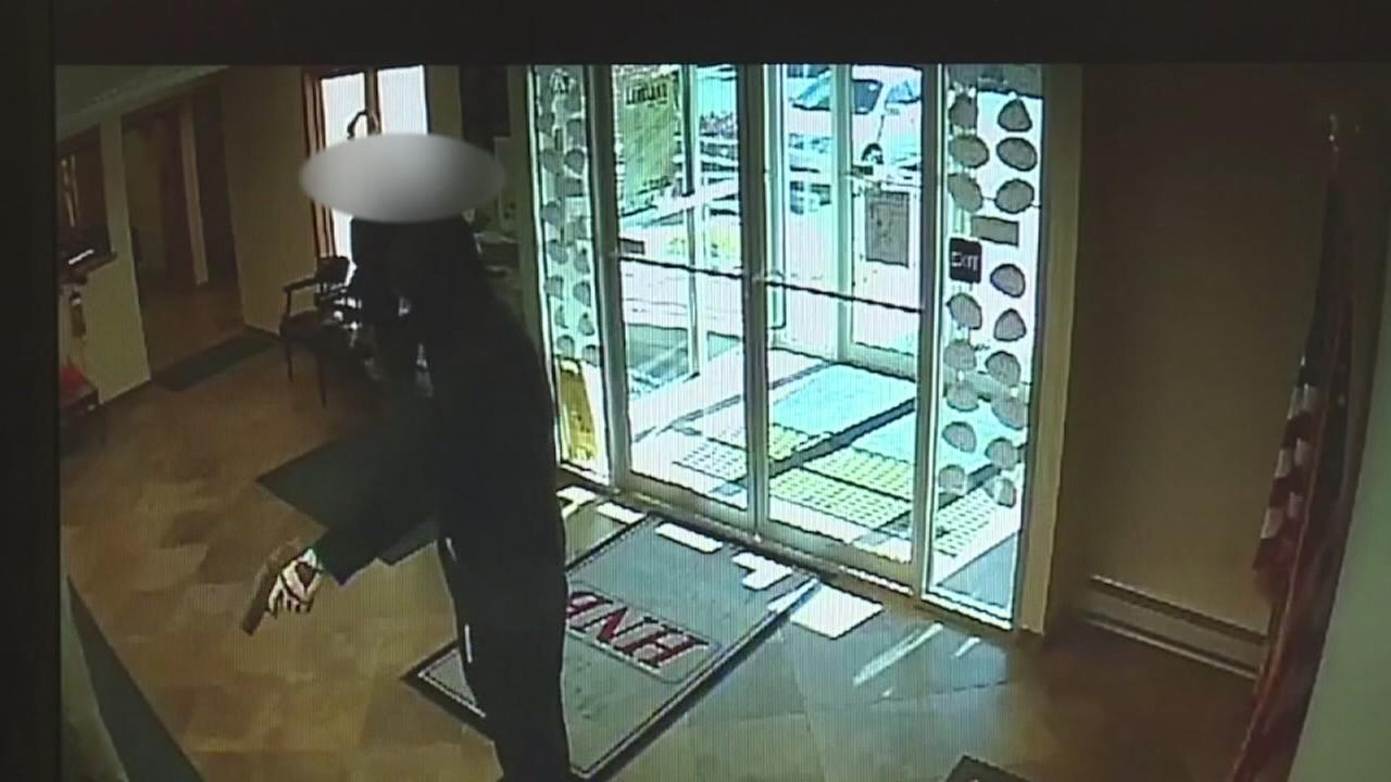 Customer tackles armed bank robber