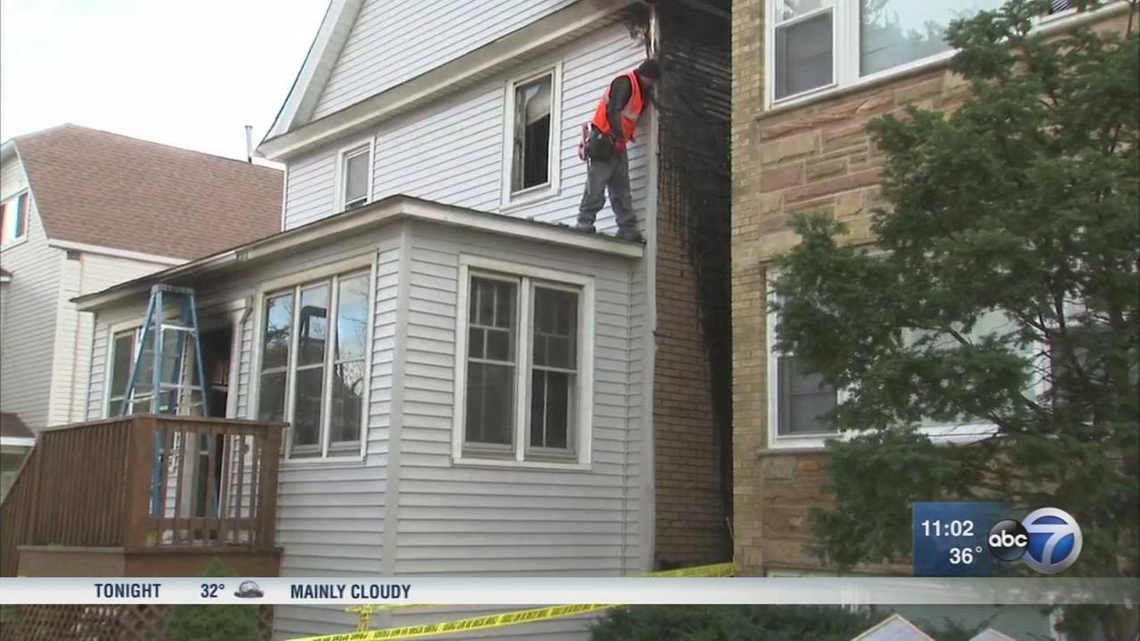 Cicero police rescue boy from house fire