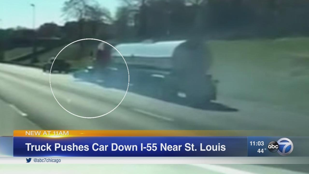 Semi pushes car down I-55