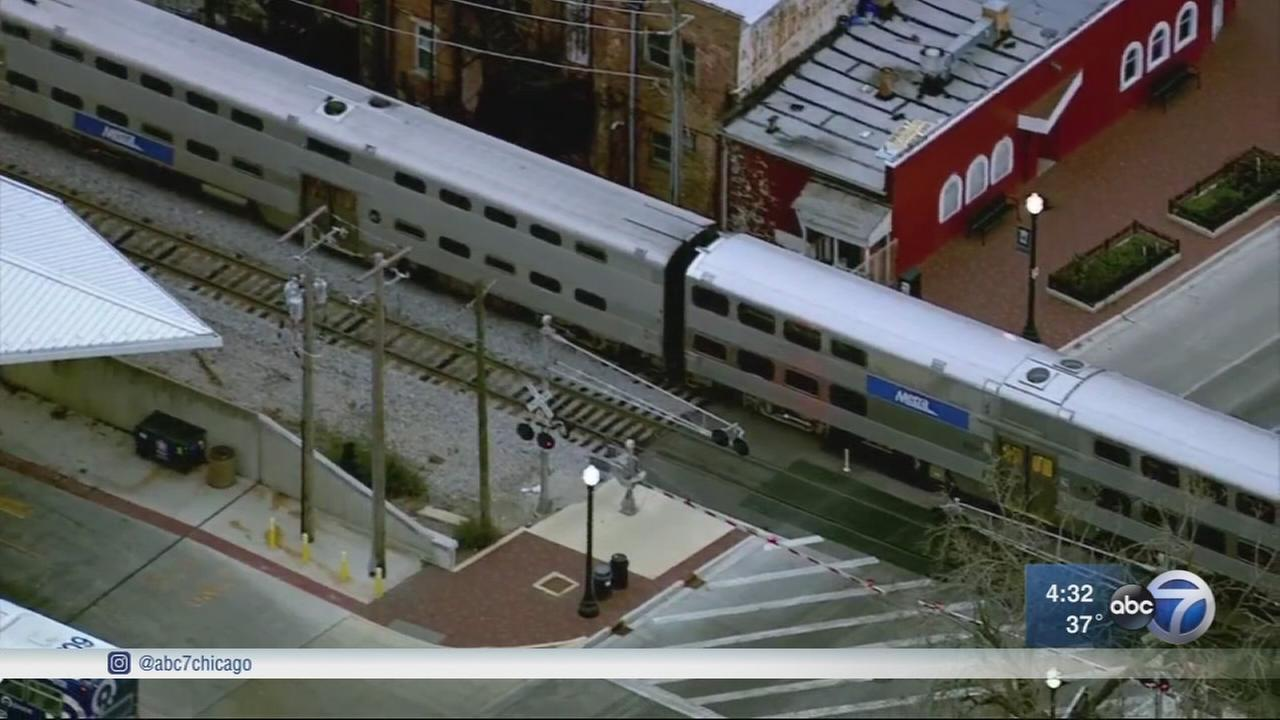 Woman trying to cross tracks fatally struck