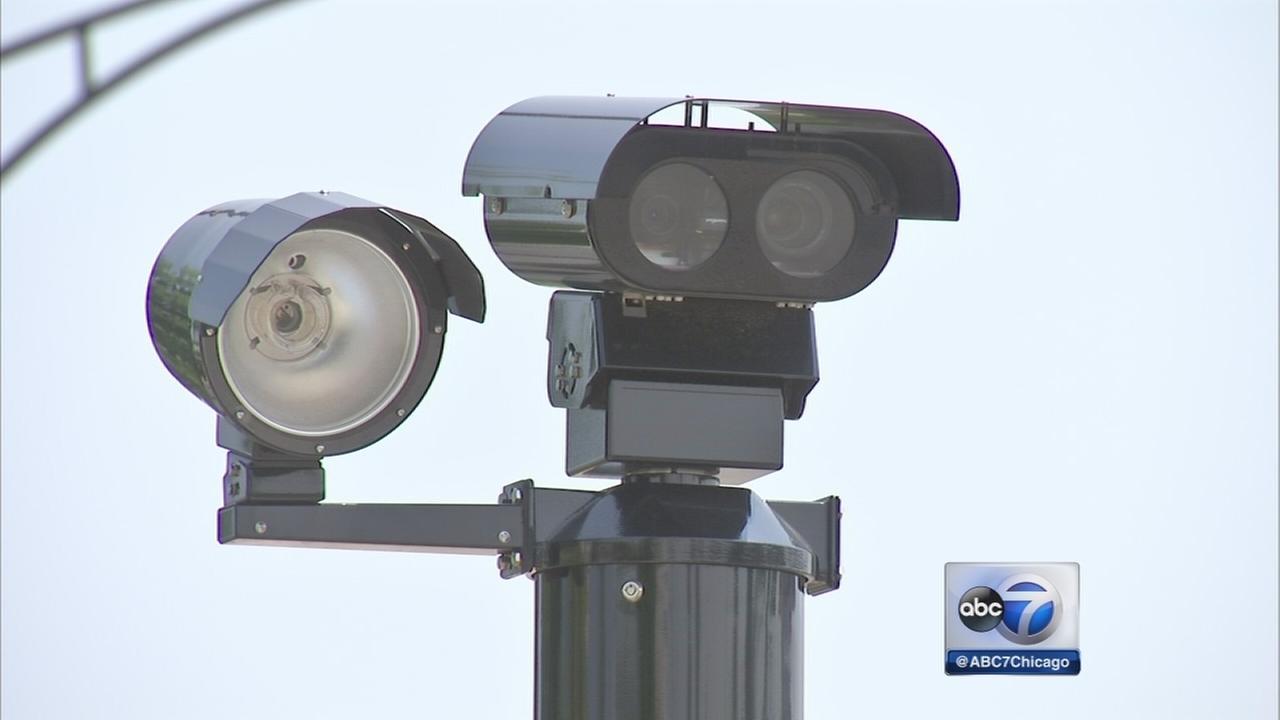 Activists challenge red light camera tickets