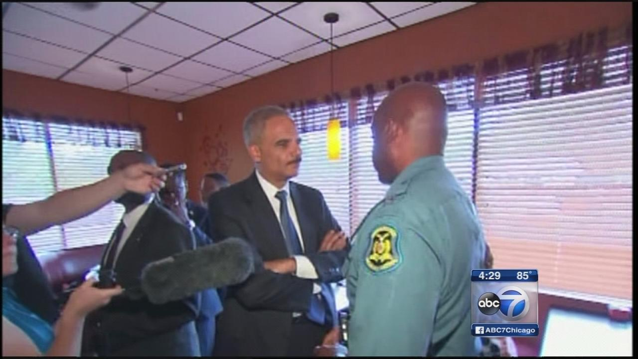 Attorney General Holder arrives in Ferguson