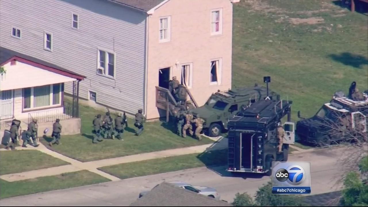 Harvey suspects in custody after standoff