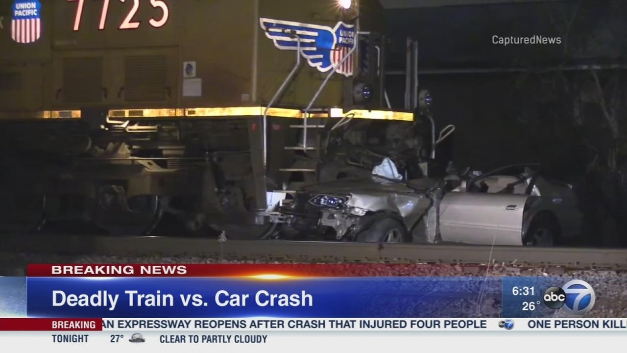 Woman killed after train strikes car