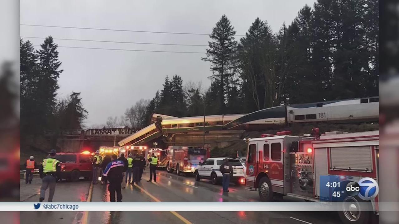 Amtrak derailment: Train car dangles over interstate after deadly crash