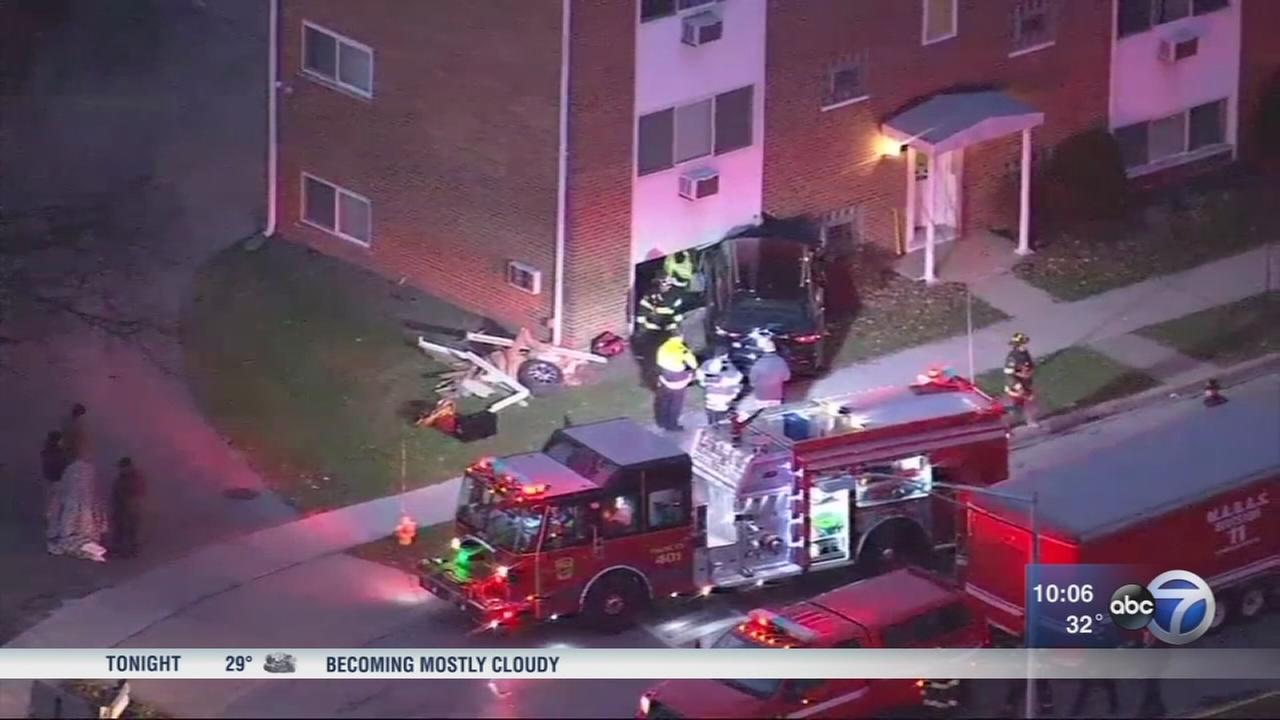 8 in custody after SUV stolen in Elmhurst slams into Forest Park apartment