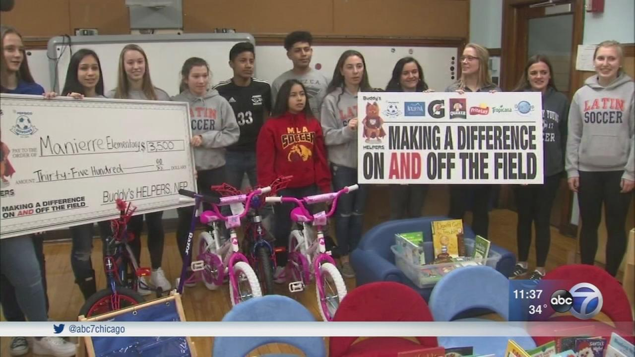 HS student athletes surprise kindergarten class with donations
