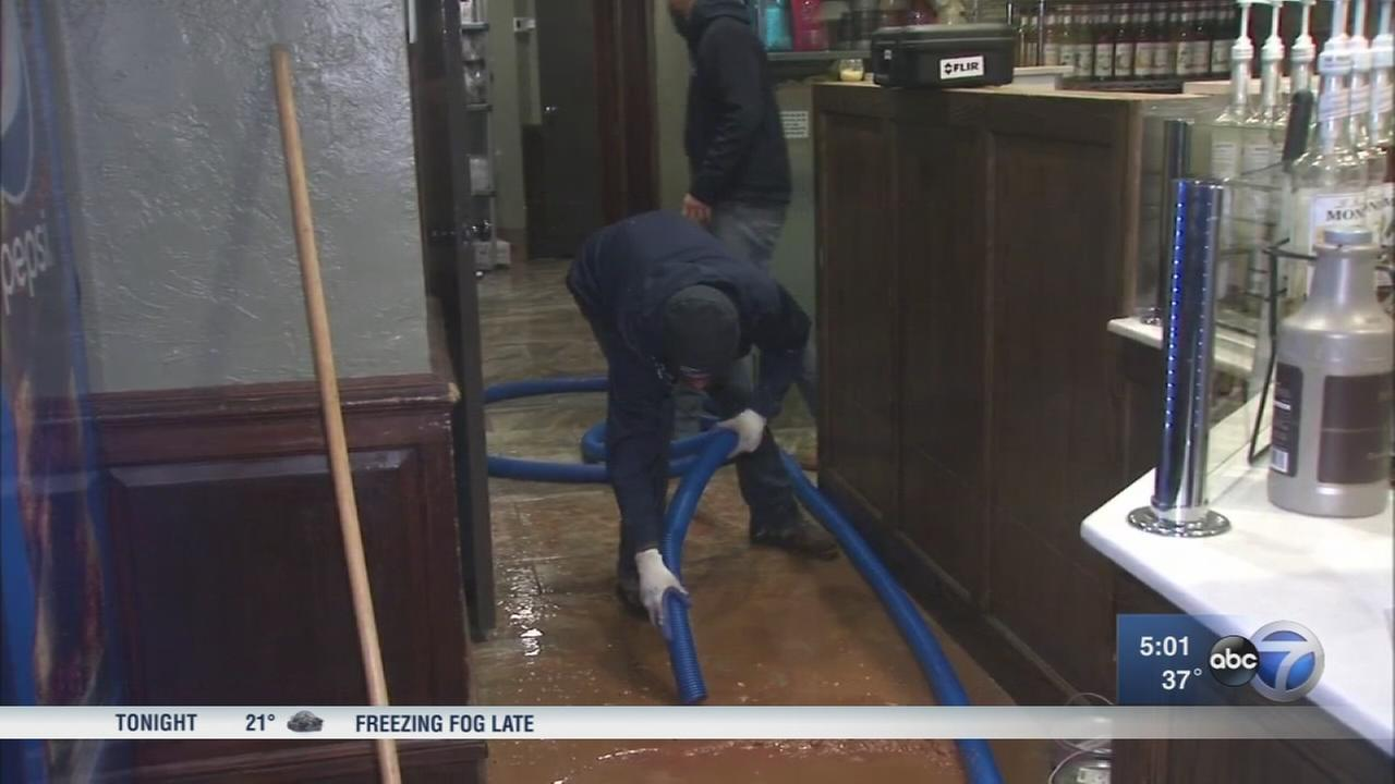 Burst pipe floods Near North Side coffee shop