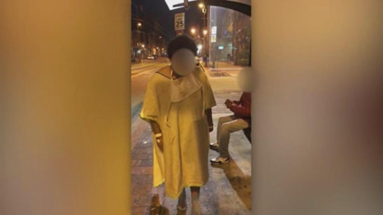 Video shows patient left at cold bus stop wearing only hospital gown, socks