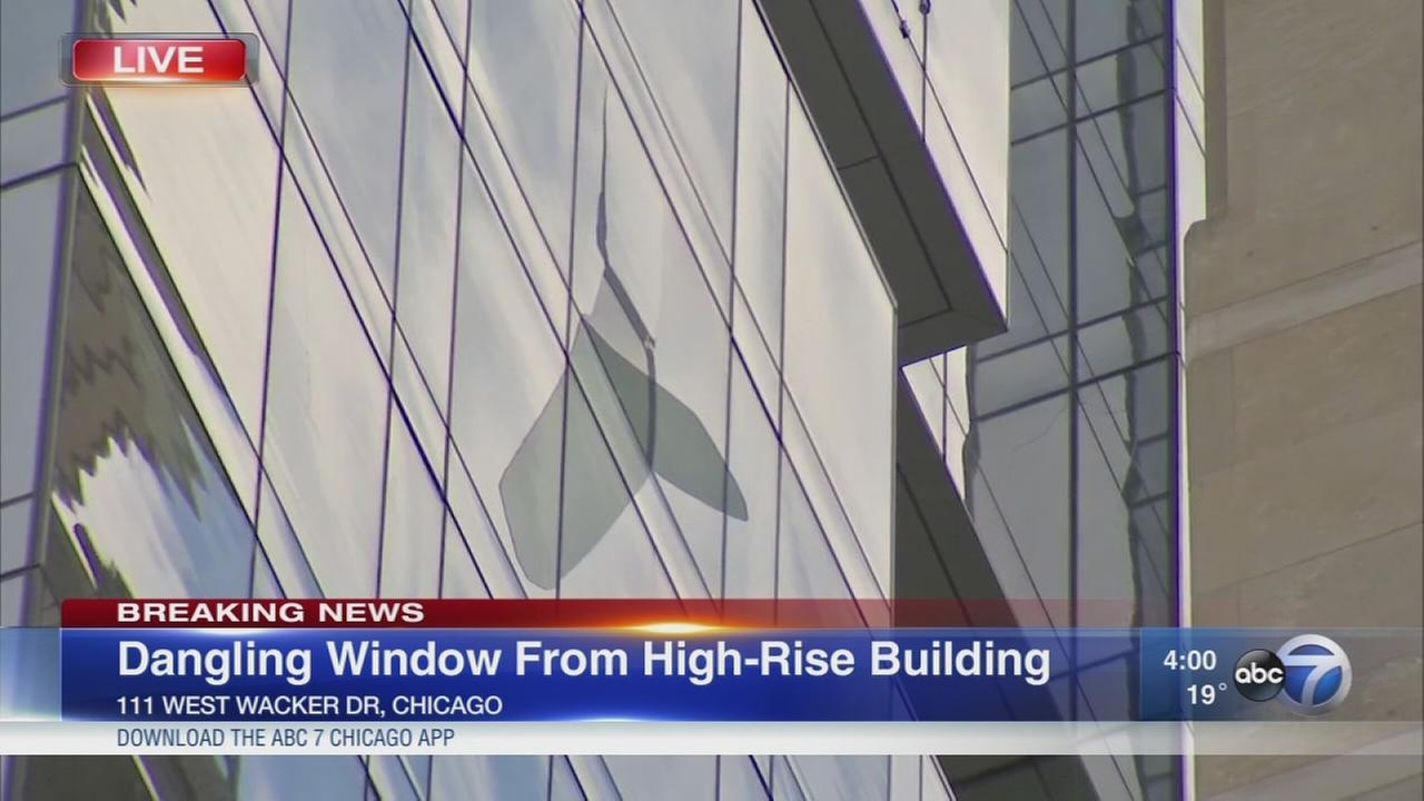 Window dangling from 26th floor Loop building