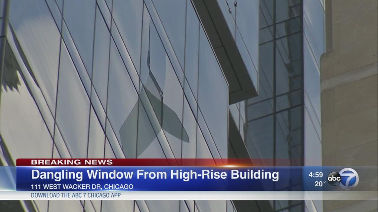 Window dangling from Loop high-rise
