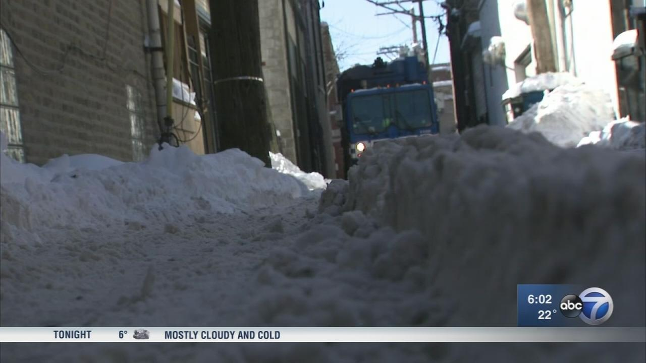Falling ice, snow-packed alleys trouble residents before warm-up
