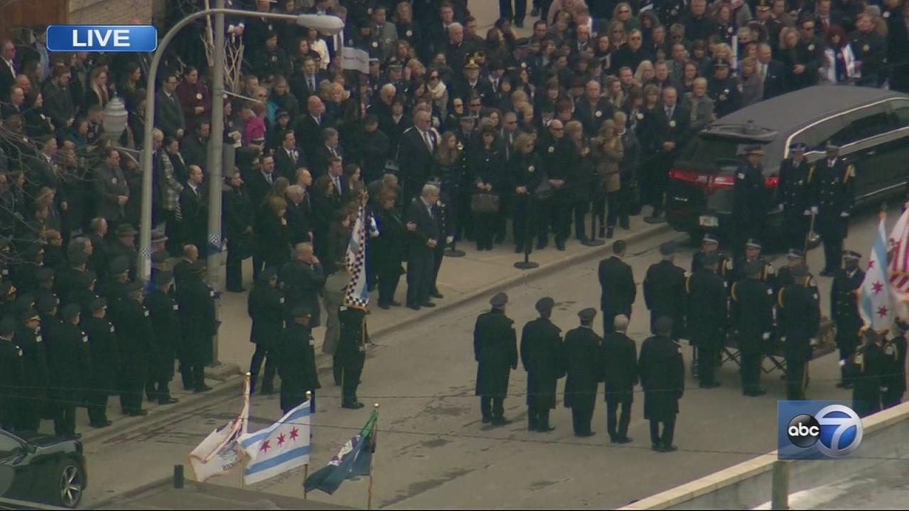 Mourners attend Cmdr. Bauers funeral