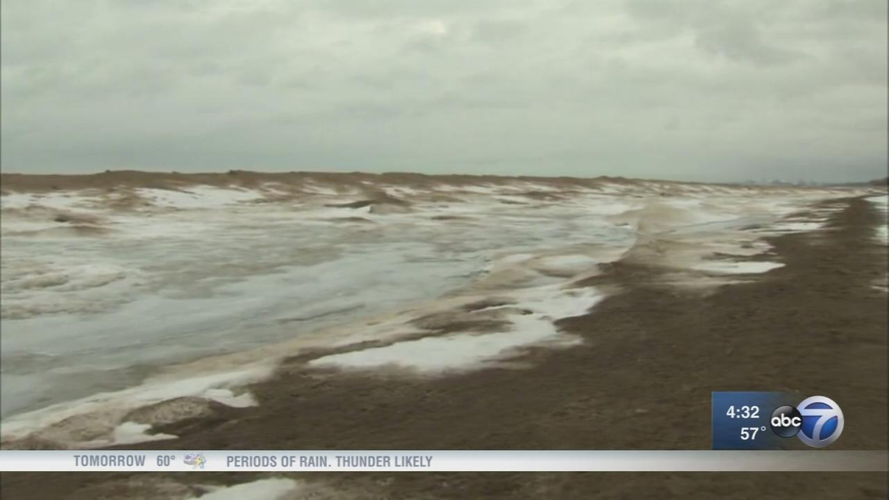 Dangerous shelf ice forms along Lake Michigan shoreline