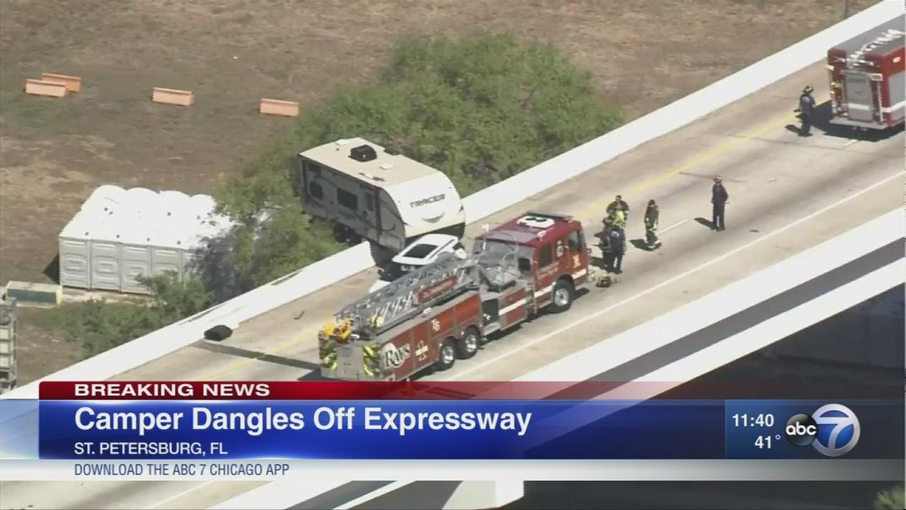 Camper dangles from Fla. expressway
