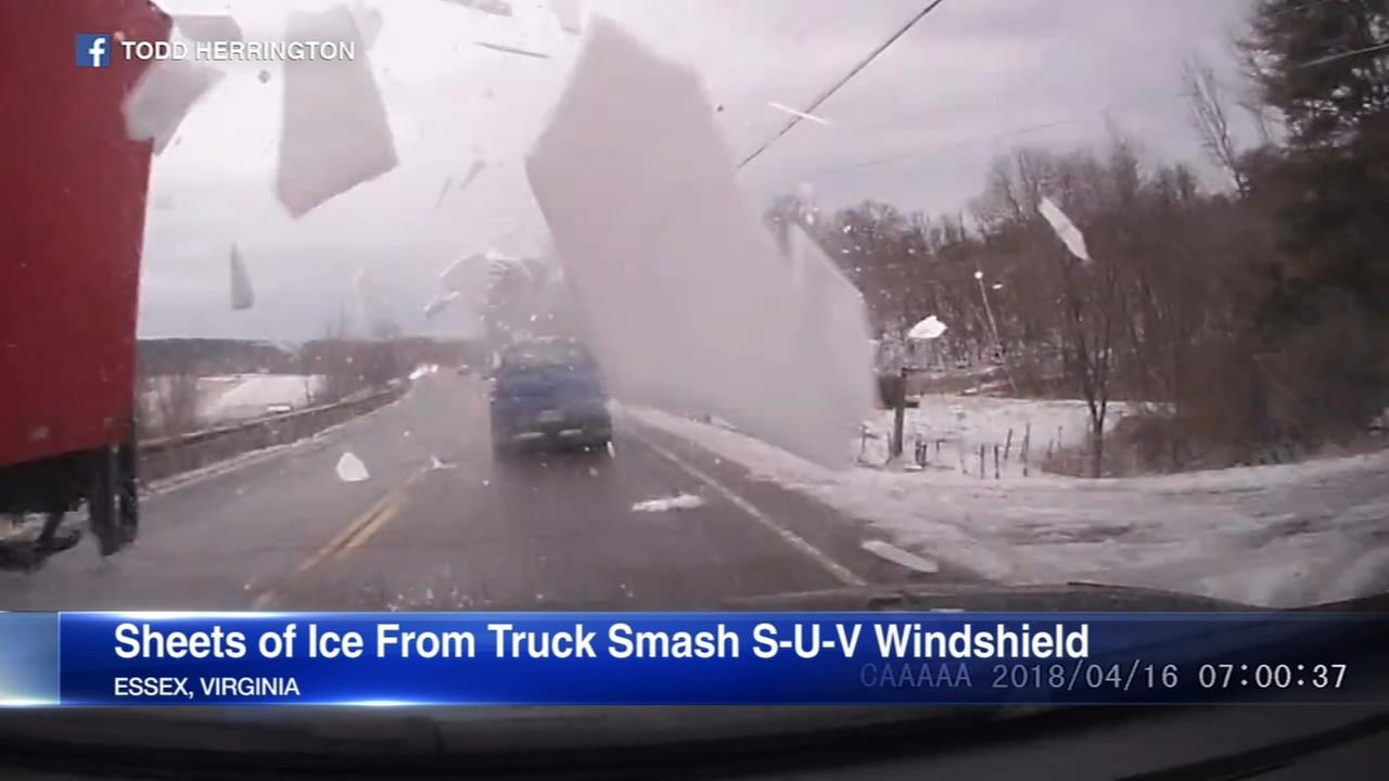 Sheets of flying snow shatter windshield on Virginia road