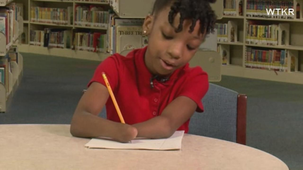 Girl born without hands wins cursive award