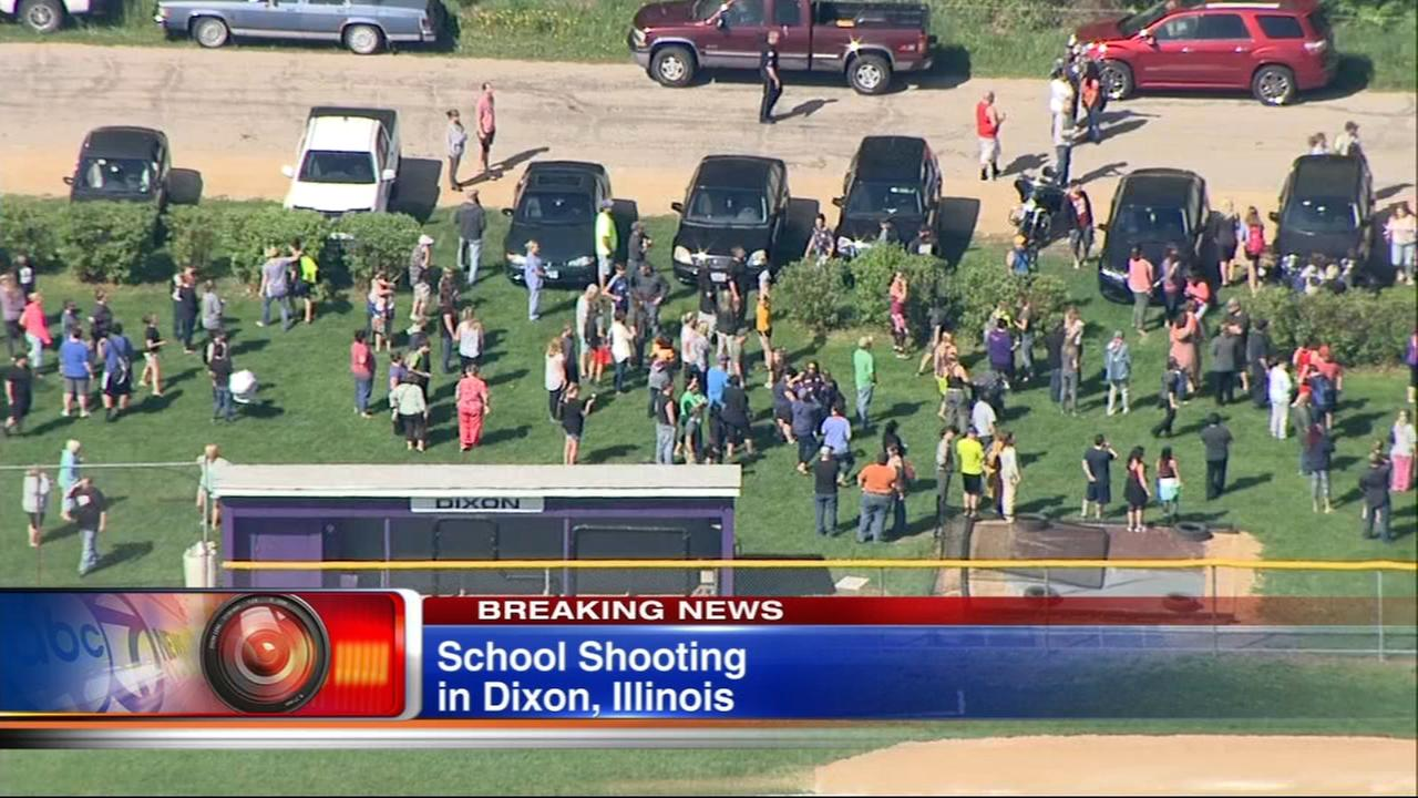 Armed male shot at police officer at Dixon High School, city says