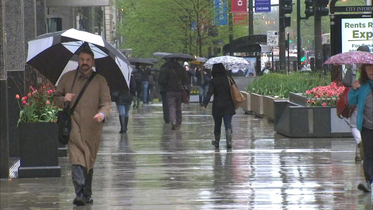 Morning downpours soak commuters