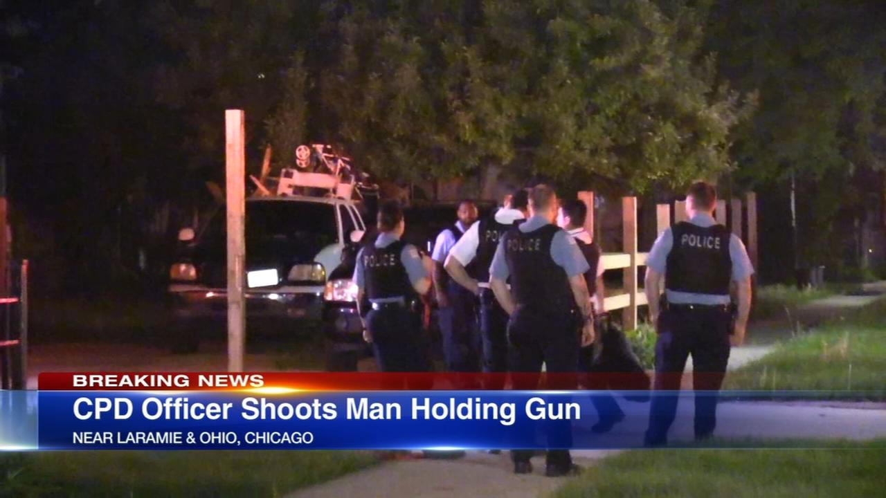 Police: Man holding gun shot by officers on West Side