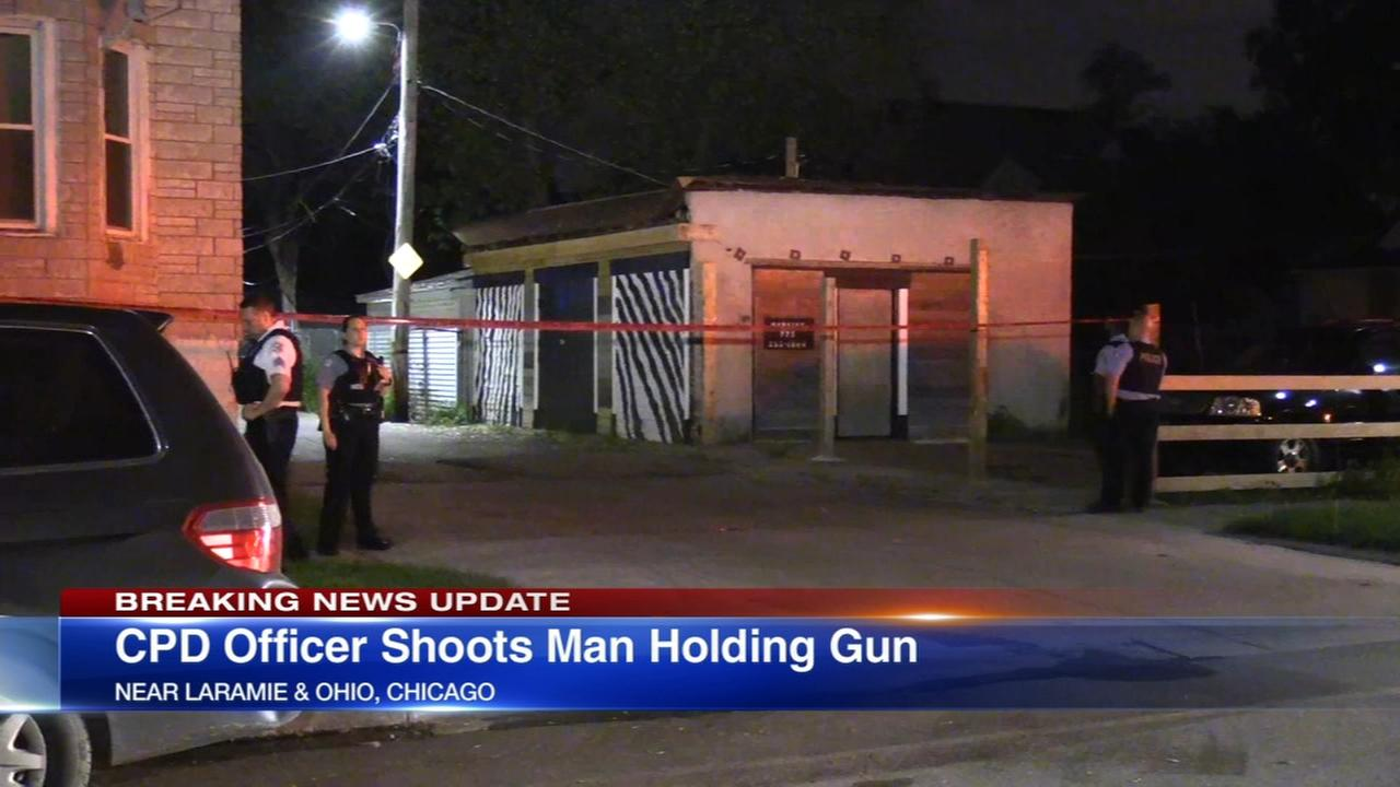 Police: Man with gun shot by officers on West Side