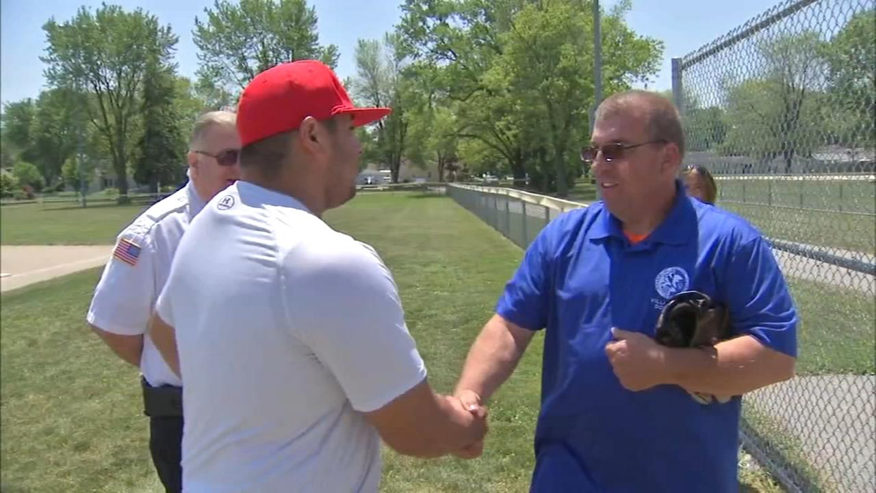 Off-duty firefighter saves softball spectator in medical distress