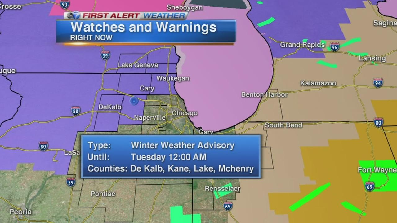 Snow falls across Chicago area